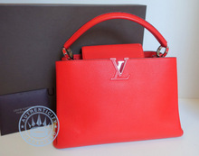 Louis Vuitton CAPUCINES MM Handbag, in Red